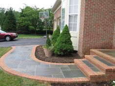 The walkway for this home expertly combines flagstones and brick to beautiful effect.