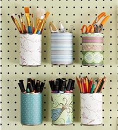 You can easily convert tin cans into charming storage containers by wrapping the cylinders with pretty paper. Punch a hole in the back of each decorated can, making it so they can all be hung via S-hooks onto pegboard. It's a stylish and practical way to organize nuts and bolts, paintbrushes and colored pencils.