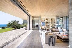 I'm usually not a fan of ultra modern home designs but good lord, this oceanfront residence in Malibu is an absolute stunner. Despite it's heavy use of concrete and glass, there is an inviting sense of warmth and airiness - perhaps it's the white oak ceilings, the lush green landscaping, or the