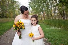 Wedding portrait. Mother and daughter. Bride and flower girl.