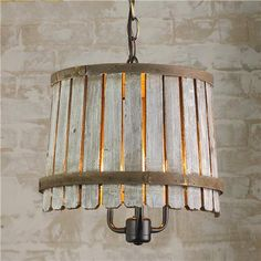 Eco Friendly wood slats and metal wine barrel bands pendant lamp. [original pin: Wood #recycling idea]
