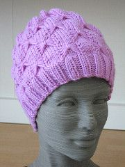 The hat is knit in the round, with the butterfly pattern continuing almost all the way through the decreases at the top of the hat.