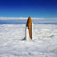 Space shuttle rising from clouds