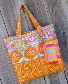 Sunshiney Day Tote and Zip Pouch - https://sewing4free.com/sunshiney-day-tote-and-zip-pouch/