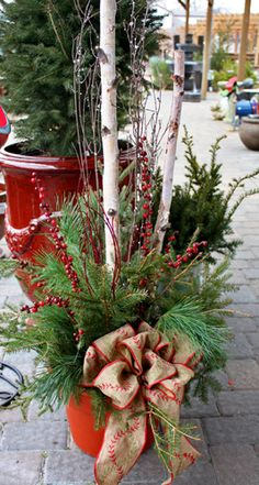 Porch Pots! Adding a custom evergreen porch pot is a great way to add a warm, holiday touch to your entryway or patio. They feature fresh evergreens, berries, dogwood and curly willow twigs, pine cones, and anything else that suits your style!