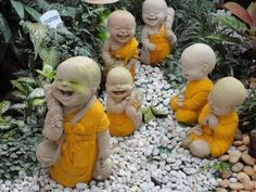 Laughing budas. I should make one of these little cuties for our garden space.