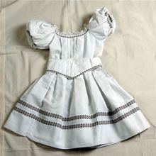 This little girl's dress dates from about 1863. (looks like something Shirley Temple would have worn)