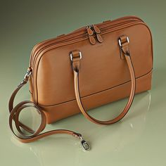 """LODIS Kaylee Business Satchel. This classic shape is beautifully designed in smooth Italian leather with an adjustable shoulder strap to fit comfortable over the shoulder or across the body. Spacious interior with large front and back sections, padded laptop sleeve and organized pockets. Toffee. 15"""" x 11"""" x 4.5"""". $328.00"""