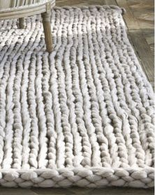 Chunky knit rug Yarn available from… Knit Rug, Rug Yarn, Wool Rug, Crochet Rugs, Fabric Yarn, Tapis Design, Interior Design Magazine, Knitting Projects, Knitting Ideas