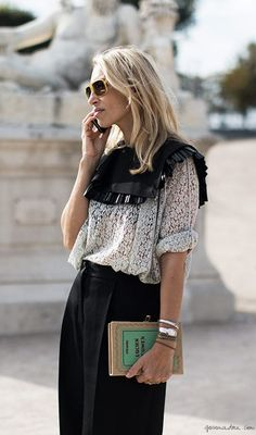 Fringe-trimmed scarf + printed blouse worn with loose trousers and a book clutch via @bjonesstyle