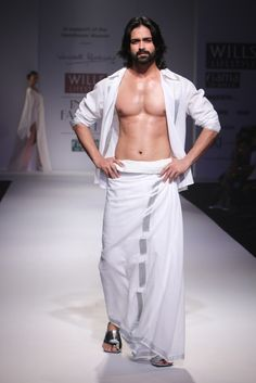 #wifw #wlifw #wifwss15 #fdci #fashionweek #WendellRodricks #wendell #invogue #elegant #handloom #yoga #textiles #calm #innerpeace #peace #spirit #allwhite #linen #shirt #trouser #silver #cotton #organza #stole #slits #shiftdress #dress #satinsilk #satin #silk #stripes #crepe #georgette #biascut #corsets #tunic #asymmetric #kerala #woven #kaftan #lungi #summer #embroidery #pyjamas #malkha #dhoti #menswear #cocktail Indian Men Fashion, Ethnic Fashion, Mens Fashion, Wendell Rodricks, Indian Man, Indian Style, Actor Photo, Dress Sketches, Trending Today