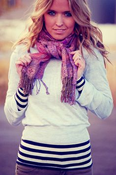 Cropped sweater over stripes