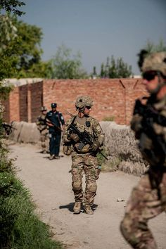 Soldiers from Whiskey Company, 2nd Battalion, 506th Infantry Regiment and Afghan Uniformed Police conduct a patrol in Khowst Province, Afghanistan on July 4, 2013.