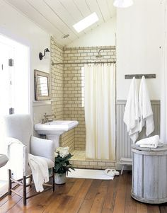 modern cottage bathroom--ceramic tile with dark grout, painted wainscotting, wood floor. I would only ask for more storage/ getting ready space. Bathroom Design Inspiration, Bad Inspiration, Modern Bathroom Design, Bathroom Designs, Design Ideas, Shower Inspiration, Casa Milano, Bathroom Renos, Bathroom Ideas