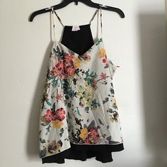 Candies reversible top Brand new with tags. It is reversible so you can either wear the all black side or the cute floral side. Size large Candie's Tops Tank Tops