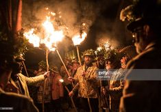 Members of the Leominster Morris lead the crowd from the Hobson Brewery in Frith Common to the nearby apple orchard to take part in a torchlit Oldfields Orchard Cider wassailing ceremony ahead of today's Twelfth Night on January 4, 2017 near Tenbury Wells in Worcestershire, England. The annual tradition sees morris dancers and mummers gather before a procession to a local orchard to perform a ceremony that involves placing a cider-soaked piece of Christmas cake on the branches of an apple…