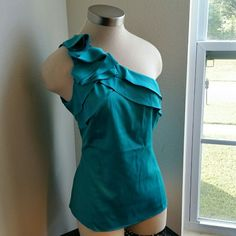 THE LIMITED....BEAUTIFUL..........SHOULDER TOP.... EXCELLENT CONDITION. .NEW LISTING..BRAND NEW. .WITH TAGS...BEAUTIFUL TOP...true to size and color...has one side shoulder top ..as shown on 2 pic up close ...it has cute ruffles on side shoulder. . color is AQUA BLUE COLOR.....is silk feel material...has no flaws...better in person........FINAL PRICE.... The Limited Tops Blouses