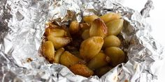 How to Roast Peeled Garlic Cloves in the Oven - Instructions and Directions - Simple instructions for roasting peeled garlic in the oven using some aluminum foil, oil and salt. Tasted just like a whole roasted head of garlic. Roasted Garlic Cloves, Baked Garlic, Veggie Dishes, Vegetable Recipes, Side Dishes, Olives, Roasting Garlic In Oven, Fresco, Garlic Recipes