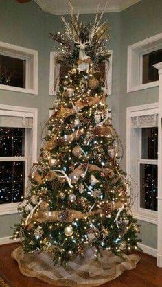 burlap christmas tree 30 Gorgeous Christmas Tree Decorating Ideas You Should Try This Year Burlap Christmas Tree, Woodland Christmas, Christmas Tree Themes, Noel Christmas, Christmas Tree Toppers, Xmas Decorations, Christmas Tree With Antlers, Xmas Tree, White Christmas