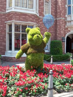 Pooh Topiary, International Flower & Garden Festival, EPCOT, Disney World, So I often go to Disney World in at the end of Febuary. It is one of their slowest times of year. During this time the Flower festival is going on at epcot and it just adds some extra niceness to your trip.