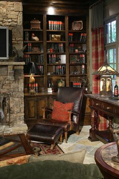 An English country reading area in your man cave is a great idea. Add slate tile flooring, stone fire place wall, iron and glass table lamps and dark wood built in book shelves for a refined look.