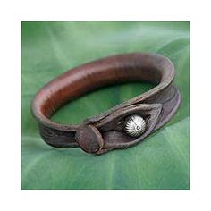 @Overstock - This handmade leather bracelet emanates a casual elegance.  The perfect addition to any ensemble, this piece of jewelry features a silver bell on the toggle closure.http://www.overstock.com/Worldstock-Fair-Trade/Leather-Sleek-Chic-Bracelet-Thailand/3318779/product.html?CID=214117 $46.49