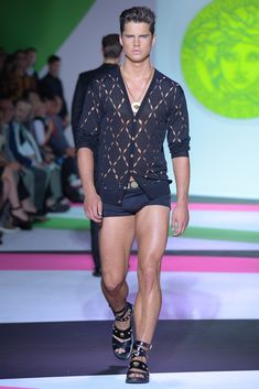 Versace Men's RTW Spring 2014. Please tell me where I can observe this ensemble in daylight? Not in a whatever club? This is heinous . Models hot tho:)