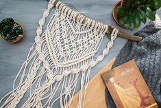 Medium Macrame Wall Hanging This medium macramé wall hanging looks great in boho, vintage, rustic and Scandinavian interiors. It is made of 4 mm natural colour cotton rope, designed and handmade with care and attention to detail. Sticks (holders) are gathered and carefully selected for