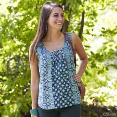 Sleeveless Turquoise Batik Tunic  Soft cotton is hand blocked by women artisans in India to create the double-floral batik pattern on this sleeveless tunic. Scooped neckline draws focus to mirror embroidered embellishments. A versatile top that goes perfectly with jeans and pants for a casual look or dress it up with a skirt. Relaxed fit; falls below hip. Machine wash cold, line dry. Handmade by @Marketplace Interiors: Handwork of India #FairTrade #India www.serrv.org