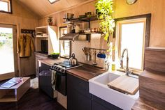 Kitchen with farm sink and propane range - Farallon by Tumbleweed Tiny House Company
