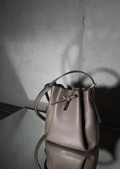 • MUD BUCKET BAG • Timeless bucket bag made out of Italien calf leather. Comes with an extra leather lining pouch to keep your valuables safe.  #bucketbag #leather #calf #accessories #bag #handbag #timeless #mud #timeless #minimal #reduced #modern #contemporary #fashion #signature #trendy #raellezurich www.raellezurich.com Bag Making, Making Out, Contemporary Fashion, Calf Leather, Mud, Bucket Bag, Calves, Minimal, Pouch