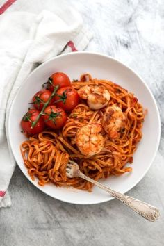 Delicious Garlic Butter Tomato Shrimp Linguine recipe made with sautéed garlic, lots of tomato sauce and buttery shrimp.  A simple but stunning pasta dinner!