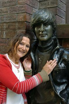 JOHN LENNON'S half-sister, Julia Baird, is pictured next to hIs statue outside the Cavern Pub on Beatles Day 2008.