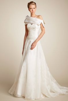 Chiffon and organza silk ball gown. Illusion neckline and cap sleeve are distinctive features of this classic wedding dress