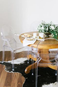 "Erin Sousa's decor picks and tips: ""I absolutely love mixing vintage items with super mod, as we did with our dining room table and chairs. My husband had to have the ghost chairs, and I softened it up a bit with an antique round solid walnut wood table."""