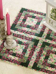 "Make an attractive, easy-to-piece candle mat with this free quilting pattern. Each block size is 9"" x 9"", and the finished candle mat size is 18"" x 18"".Skill Level: Beginner"