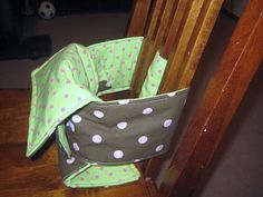 Fabric High Chair... I contoured the big rectangle to fit Baby's legs better, and made the long strap longer to fit around chairs without slats in them, comes in handy!