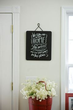 Hand-lettered message reads, We open our home in love and grace and ask God's blessing on this place.