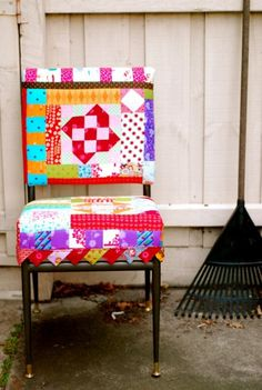 How cute is this?!?  What a wonderful way to recycle an old chair.  LOVE.  THIS.