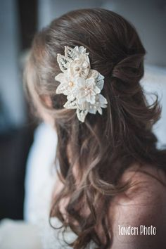 Half up half down bridal hairstyle with custom floral headpiece by Petite Lumiere