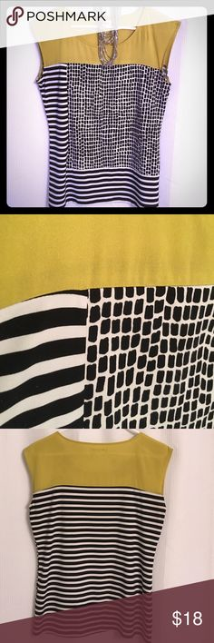 """Calvin Klein sleeveless blousy top CK sleeveless shirt with black and white stripes and checkers and a bright lemon-lime top. Airy and flowy, nice stretchy fabric (95/5 poly/spandex). Hand wash. Shoulder width approx. 4.5"""", length (top of shoulder to bottom of shirt) approx. 25"""", 38"""" chest. Looks killer w/ a black pencil skirt and heels, white dress pants or dark wash jeans. Calvin Klein Tops Tees - Short Sleeve"""