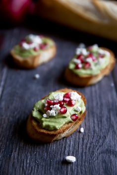 Whipped avocado and feta spread on garlic toasted bread and topped with pomegranate seeds. An easy, festive appetizer with simple, delicious ingredients.