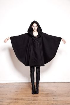 Ovate Black Hooded Wool Cloak (DO NOT TRUST THIS SITE. This beautiful cloak does not exist. The designer apparently only ever made one and is done. -_-)