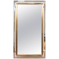 Chrome and Brass Mirror in the Manner of Romeo Rega | From a unique collection of antique and modern wall mirrors at https://www.1stdibs.com/furniture/mirrors/wall-mirrors/