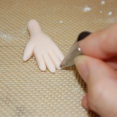 Hand Using Piping Tip to Create Fingernails