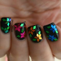 This nail art features a floral design using different colors of diamond glitter glequins on a black nail polish. Learn how to do this style with these products for DIY.