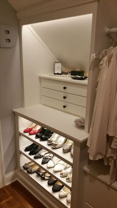 Custom Walk-in Closet, slanted ceilings...jewelry drawers and pull-out shelves for shoes.