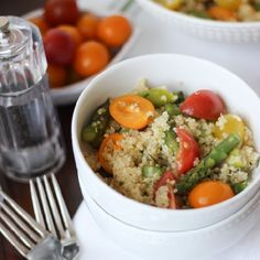 Bright and fresh asparagus and cherry tomatoes are mixed with healthy and hearty quinoa and then tossed in a simple lemon basil vinaigrette.