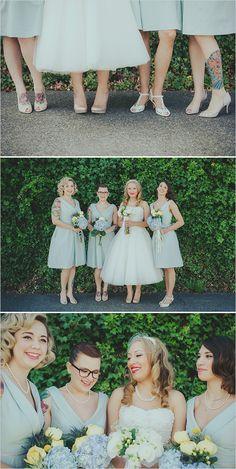 Pastel tea length bridesmaid dresses.