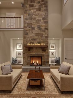 This fireplace was handcrafted and dry-stacked by an artisan mason who shaped and placed each stone by hand. Our designer hand-picked stones from each palate to coordinate with the interior finishes. Remaining stones were also hand-selected for the outdoor kitchen, adjacent to this space.